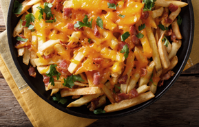 French Fries with cheddar , bacon and parsley
